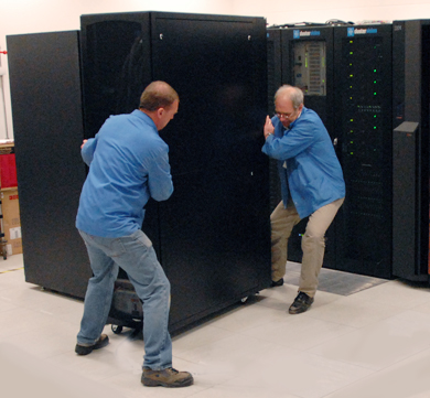 Cray personnel move the XT4 cabinet into place. (Photos: P.Tuffy, University of Edinburgh)