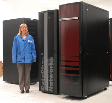 EPSRC HECToR Project Manager Jennifer Houghton with the system.  Right, the XT4; centre: main disk storage; left, boot disk drives. (Photos: P.Tuffy, University of Edinburgh)