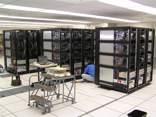 HECToR XT4 units under construction (March, 2007) at the Cray facility at Chippewa Falls, MN.  Note that the finished cabinets will have proper cladding. (Photos: Cray Inc)